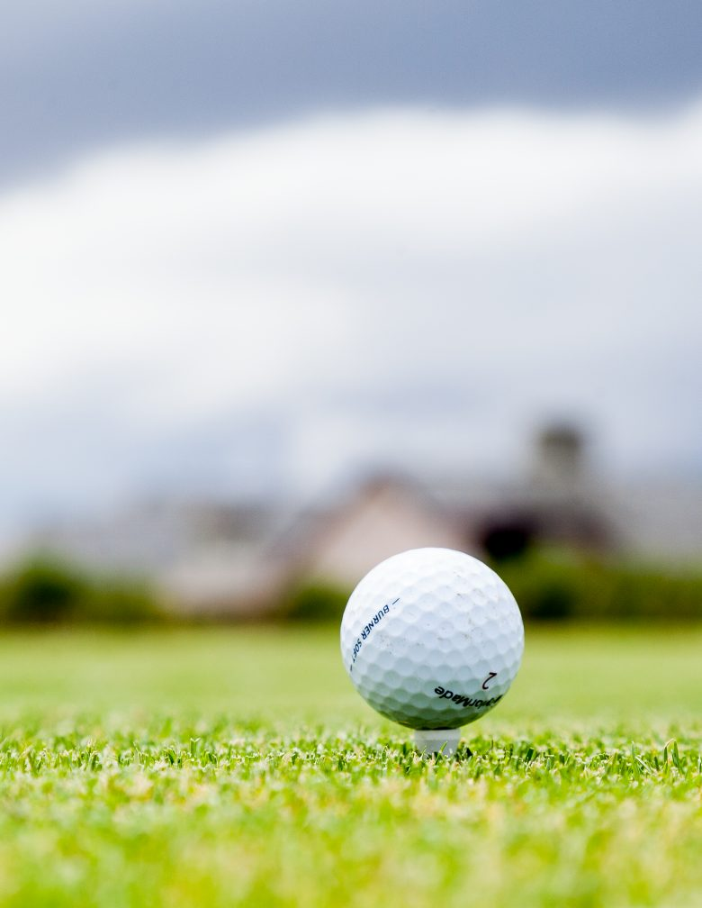 Detail of golf ball prior to player teeing off.