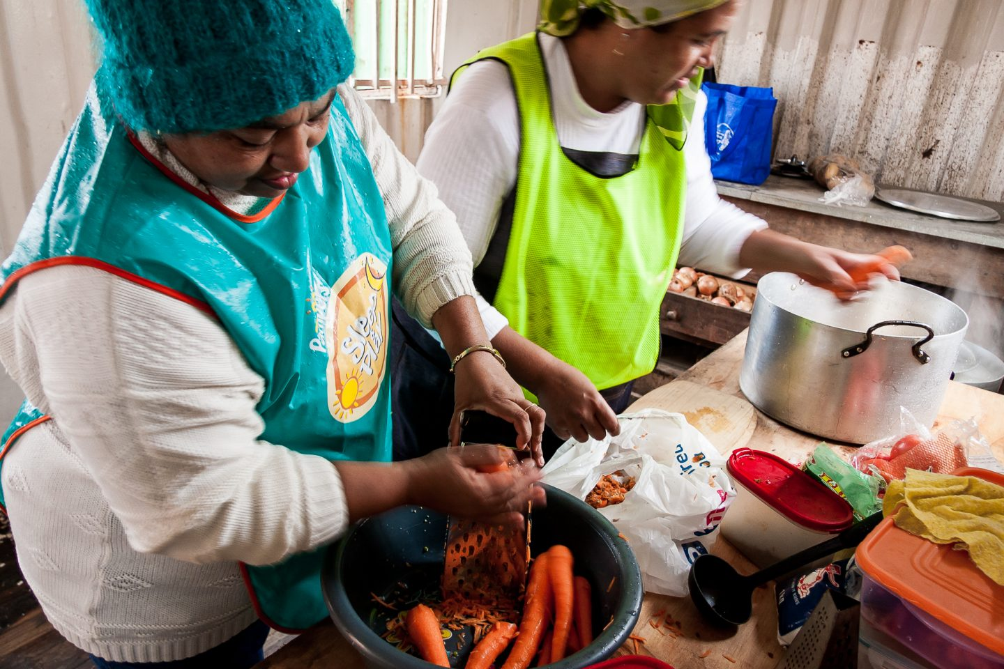 Gamieda Booysen and Ruwayda Ryklief prepare soup for the communities children and youth.