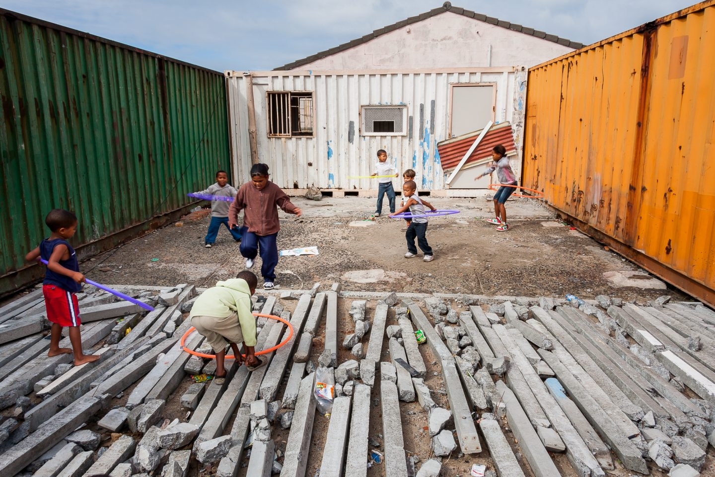 Children playing in front of the containers. Fully aware that this will at some point become a place for them to play music, dance and get after school education.