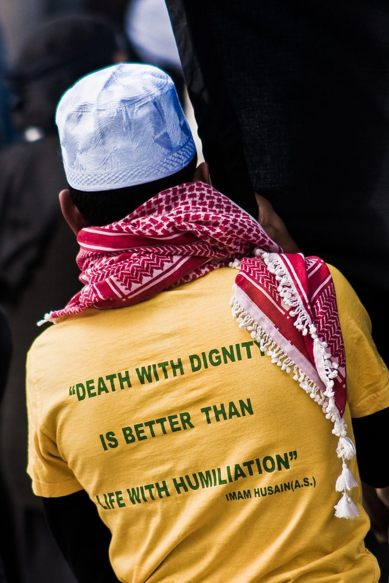 "T-shirt with a quote by Imam Husain: ""Death with dignity is better than life with humiliation."""