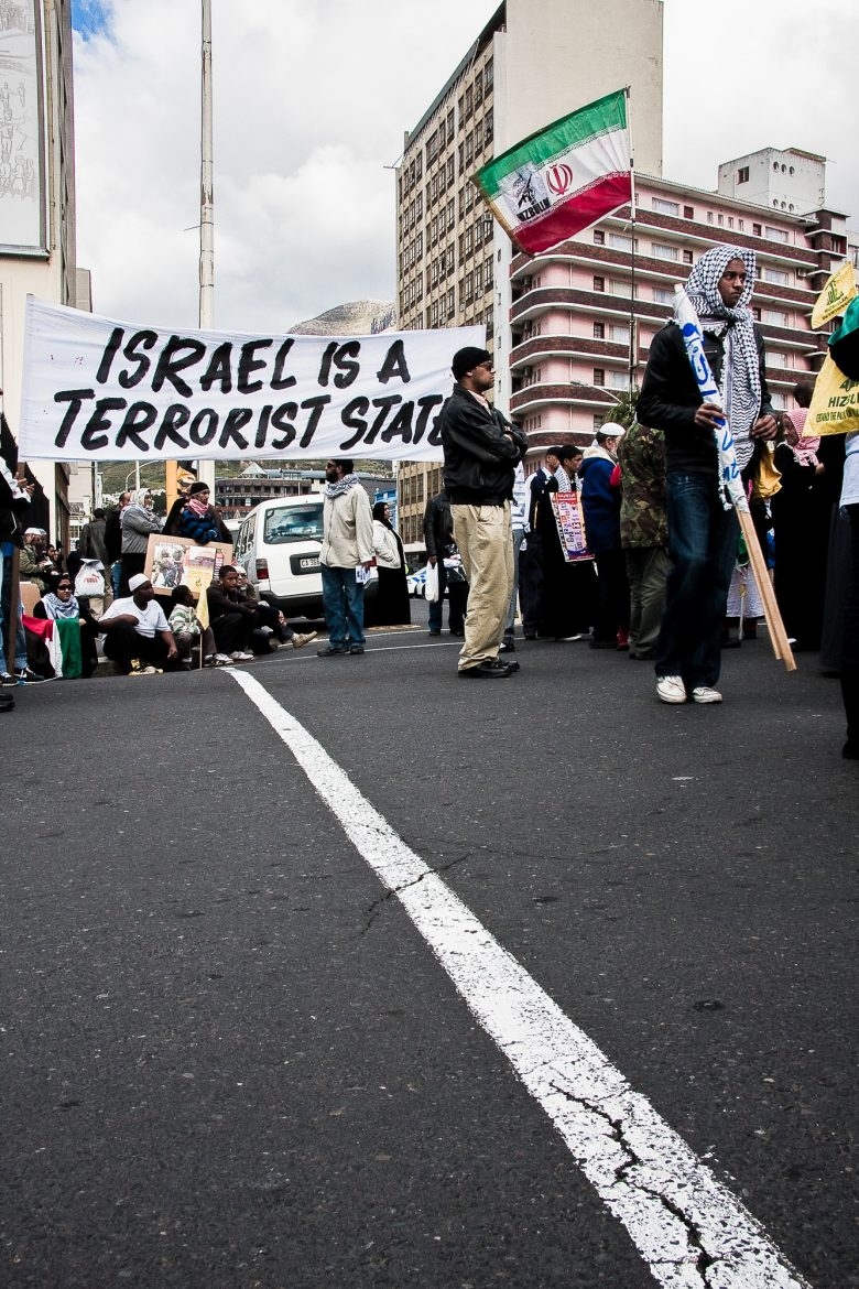 "banner with the slogan ""Israel is a terrorist state""."