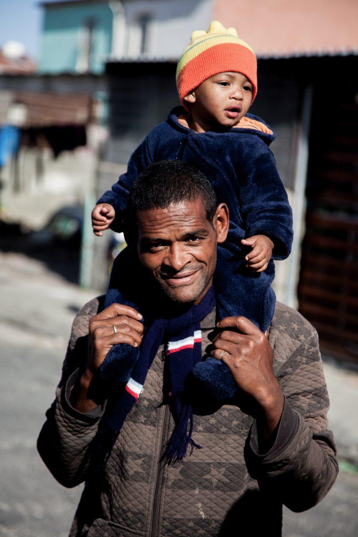 Gavin van Sensie (37) with his 10 month old son in Tafelsig, Cape Town.