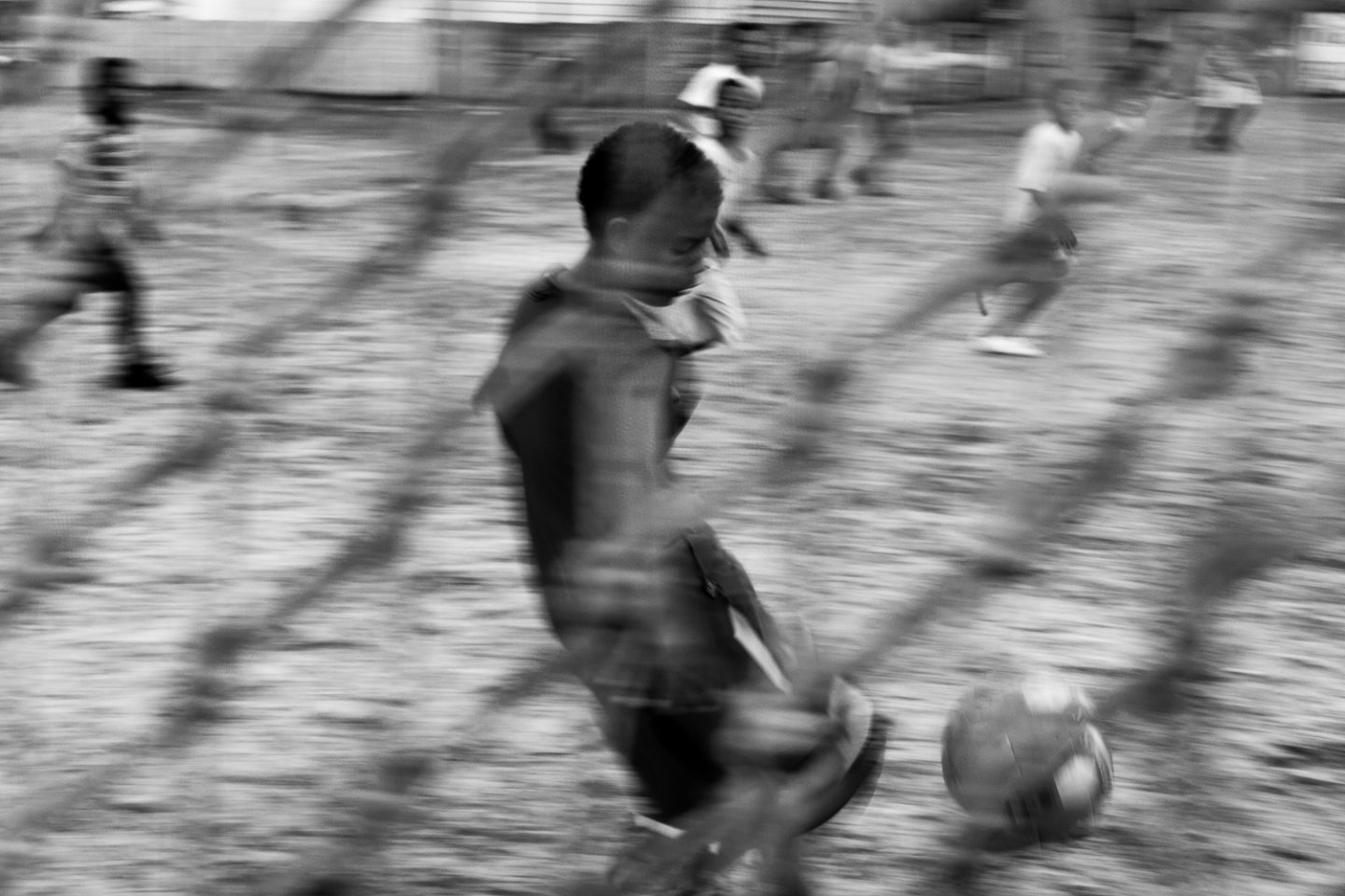 Children playing football on a community field, Mitchell's Plain, 2011.