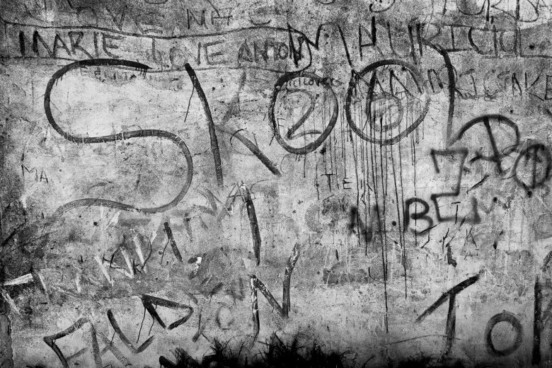 "Detail of wall with the word ""Skool"" and gang related tags, Mitchell's Plain, 2013."