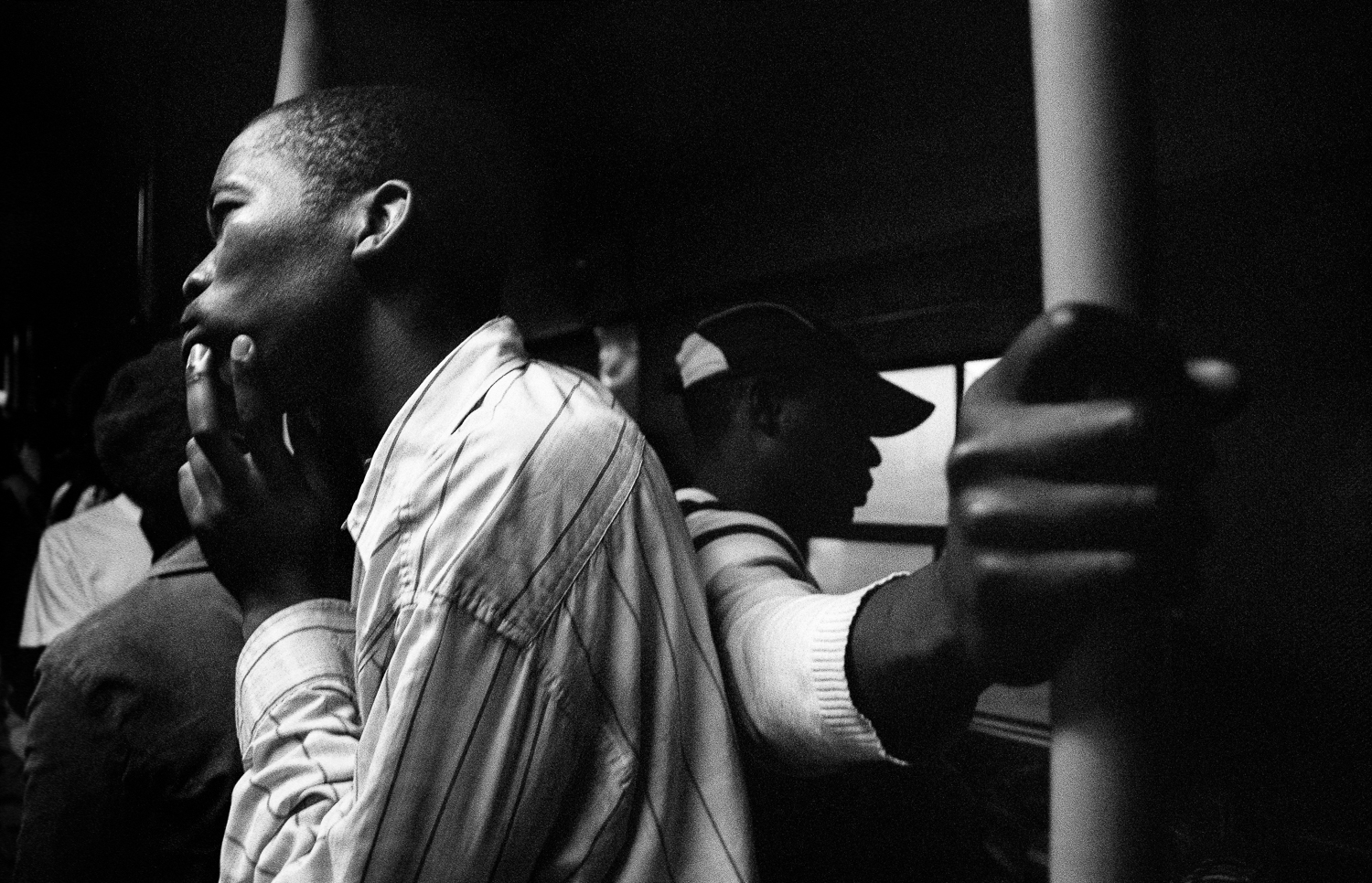 Workers on the night train to Khayelitsha, Cape Town, 2010.