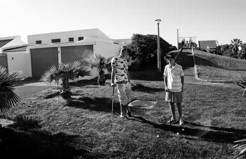 Teenagers playing golf, Marina da Gama, 2011.