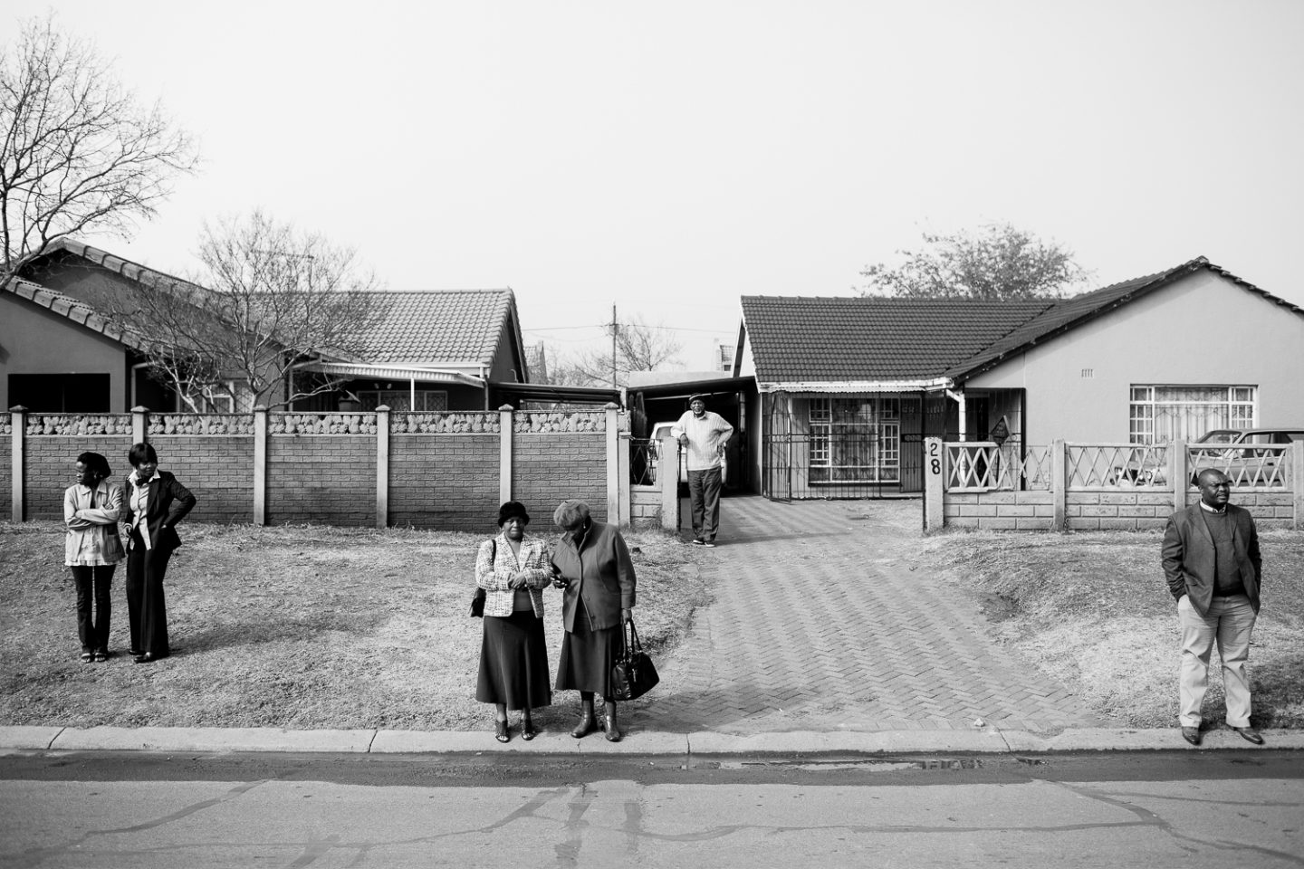 The morning of a funeral. Family is standing ready to go to the cemetary for the unvelling of a tombstone and funeral, Eldorado Park 2015.