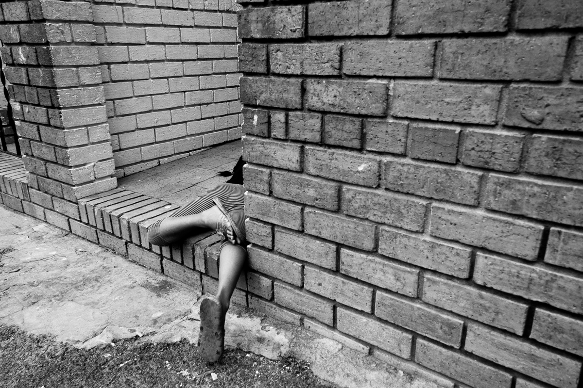Child playing in the yard, Salt River 2012.