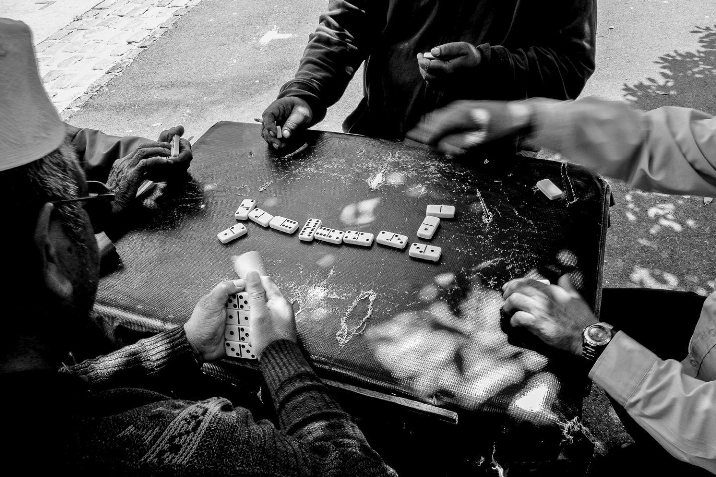 Men playing a game of Dominos in the street, Woodstock 2014.