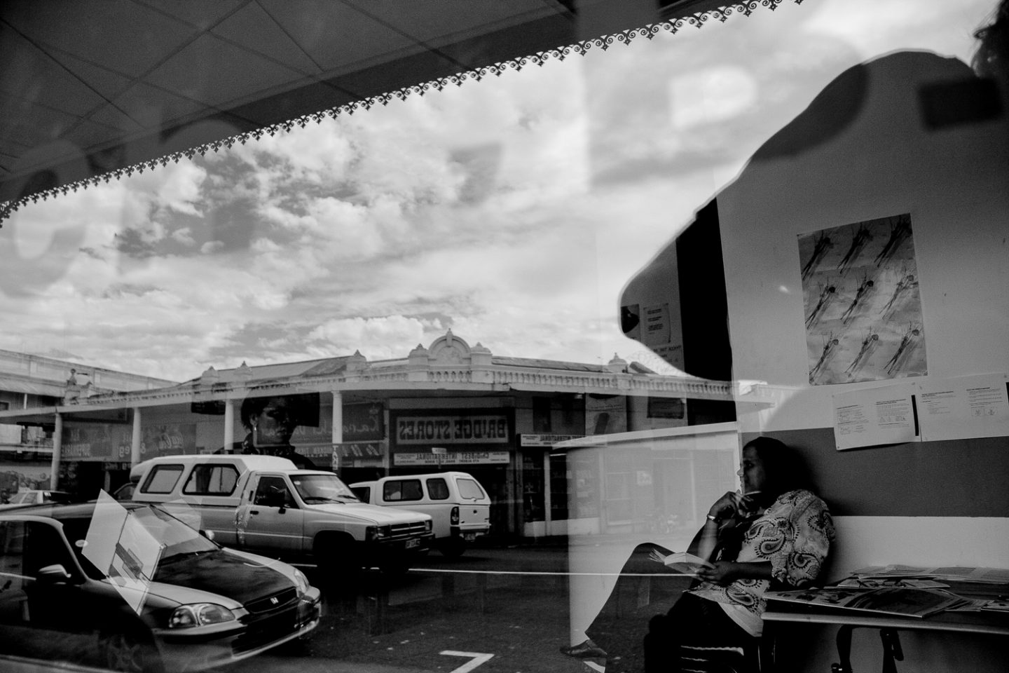 Woman waiting at the hair dresser, Salt River Main Road, 2012.