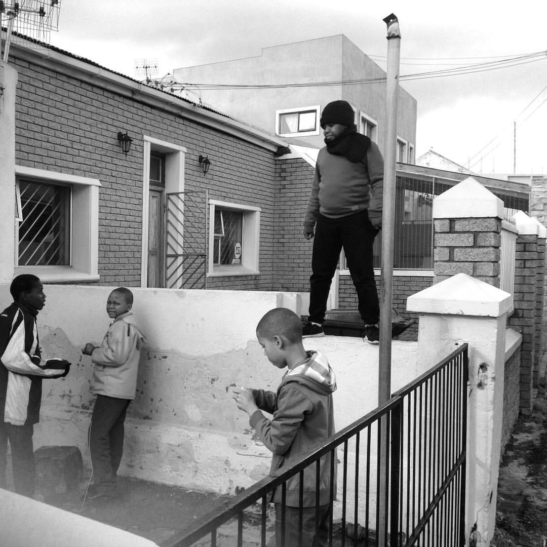 Children playing in the yard as Winter winds and cold swept in over Cape Town, 2016.